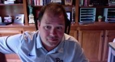 Chris Bonneau in front of bookcase