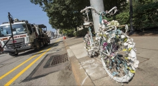 Ghost bike tied to pole on Forbes Avenue