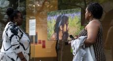 Women looking at artwork