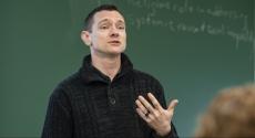 Brook Bahler in front of chalkboard