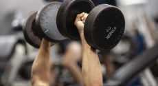 Arms lifting weights