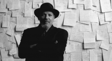 August Wilson in front of board full of papers