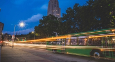 Bus trailing lights near Cathedral of learning
