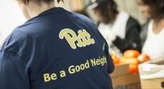 Pitt volunteer with Be a Good Neighbor t-shirt