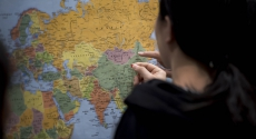Student placing pin on map