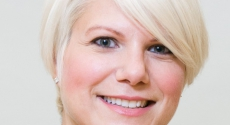 Tight headshot of blonde woman