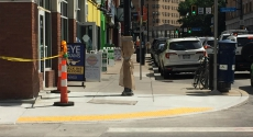 Ramp with hazard tape on Forbes Avenue