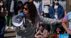 Actress Sandra Oh speaking with bullhorn