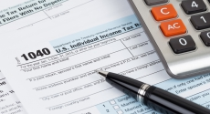Tax forms, pen and calculator