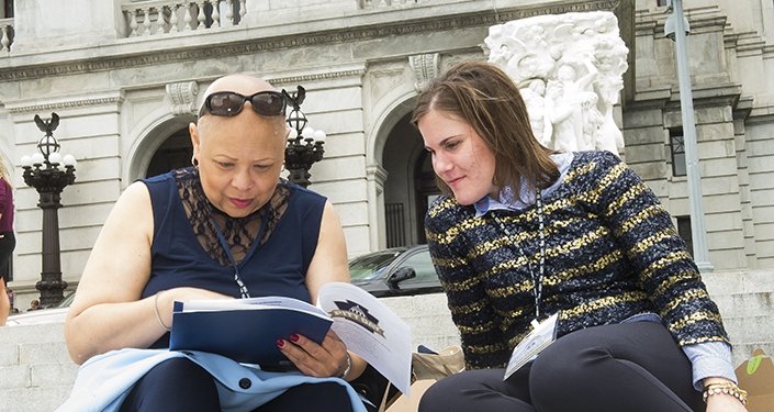 Camille Burgess, Victoria Ivock on steps to capitol