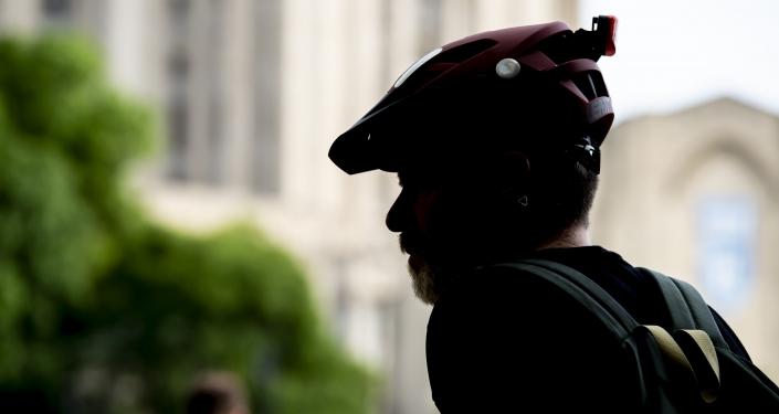 silhouette of man in bike helmet