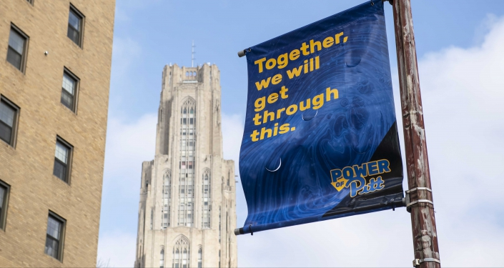 Banner with Cathedral of Learning in background
