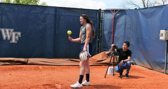 Softball pitcher and tech tracking her throw