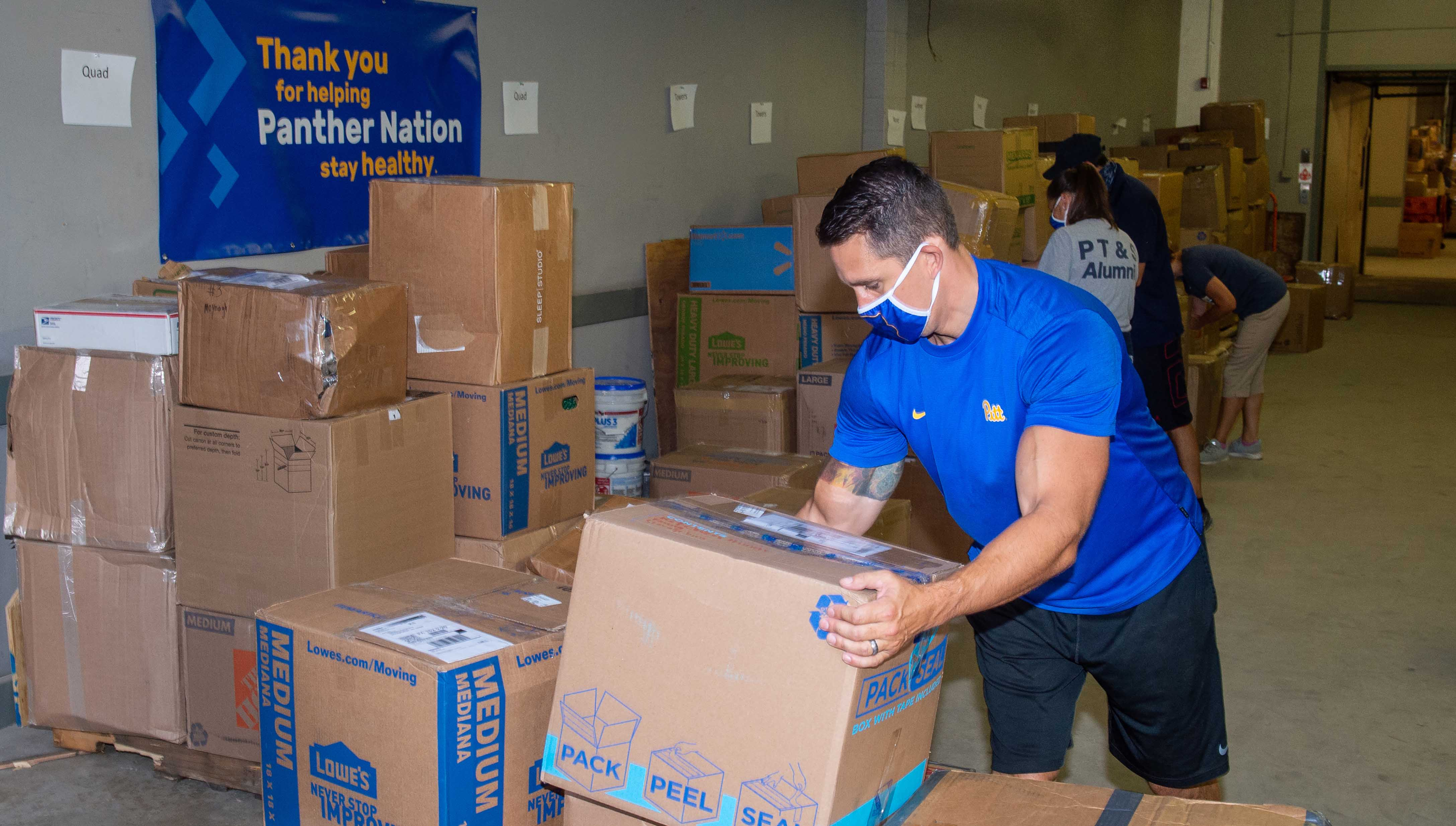 Staff sort through boxes sent to Pitt by students