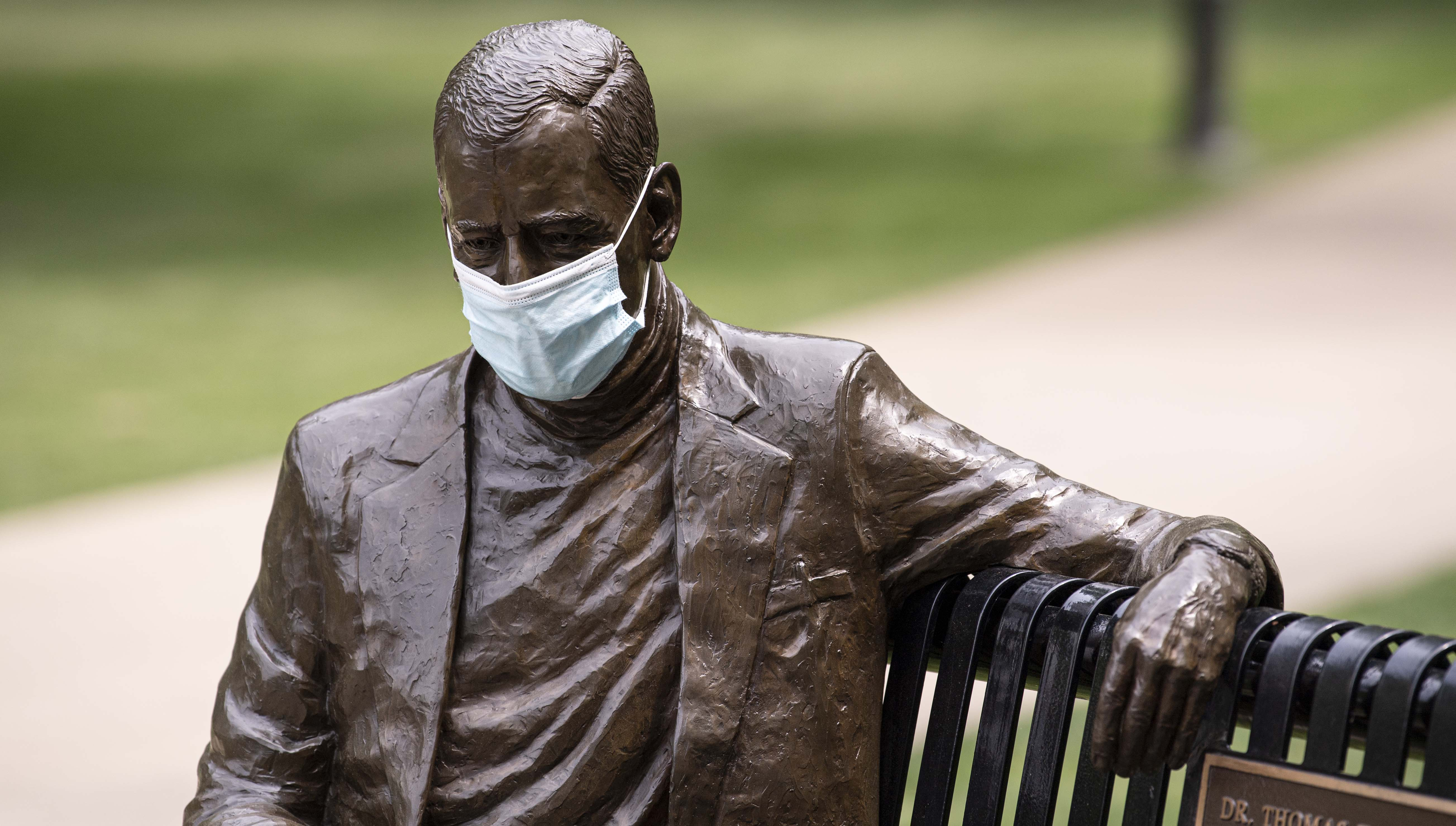 Statue of Thomas Starzl with face mask