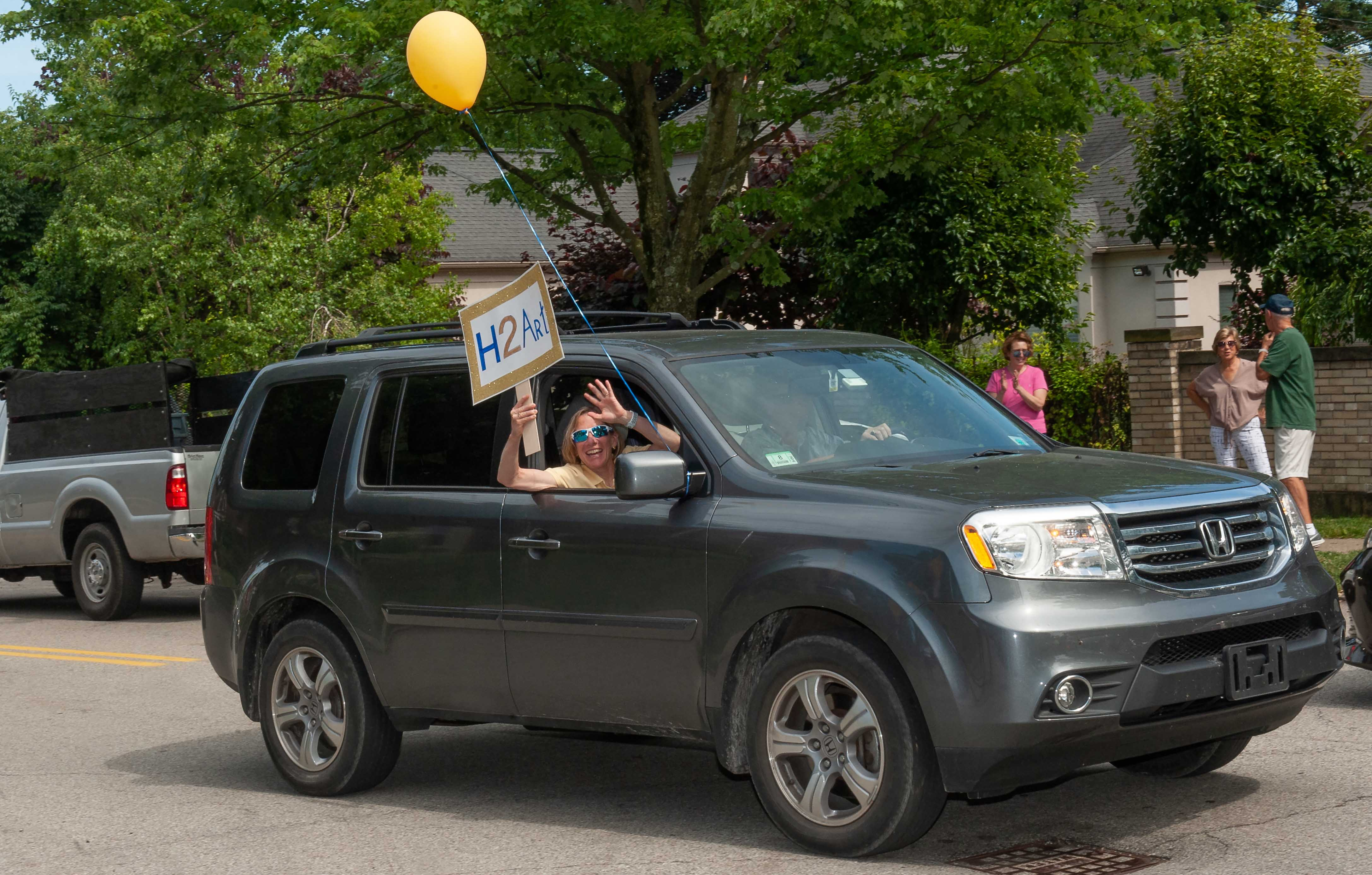 Provost Ann Cudd drives by Art Levine's house