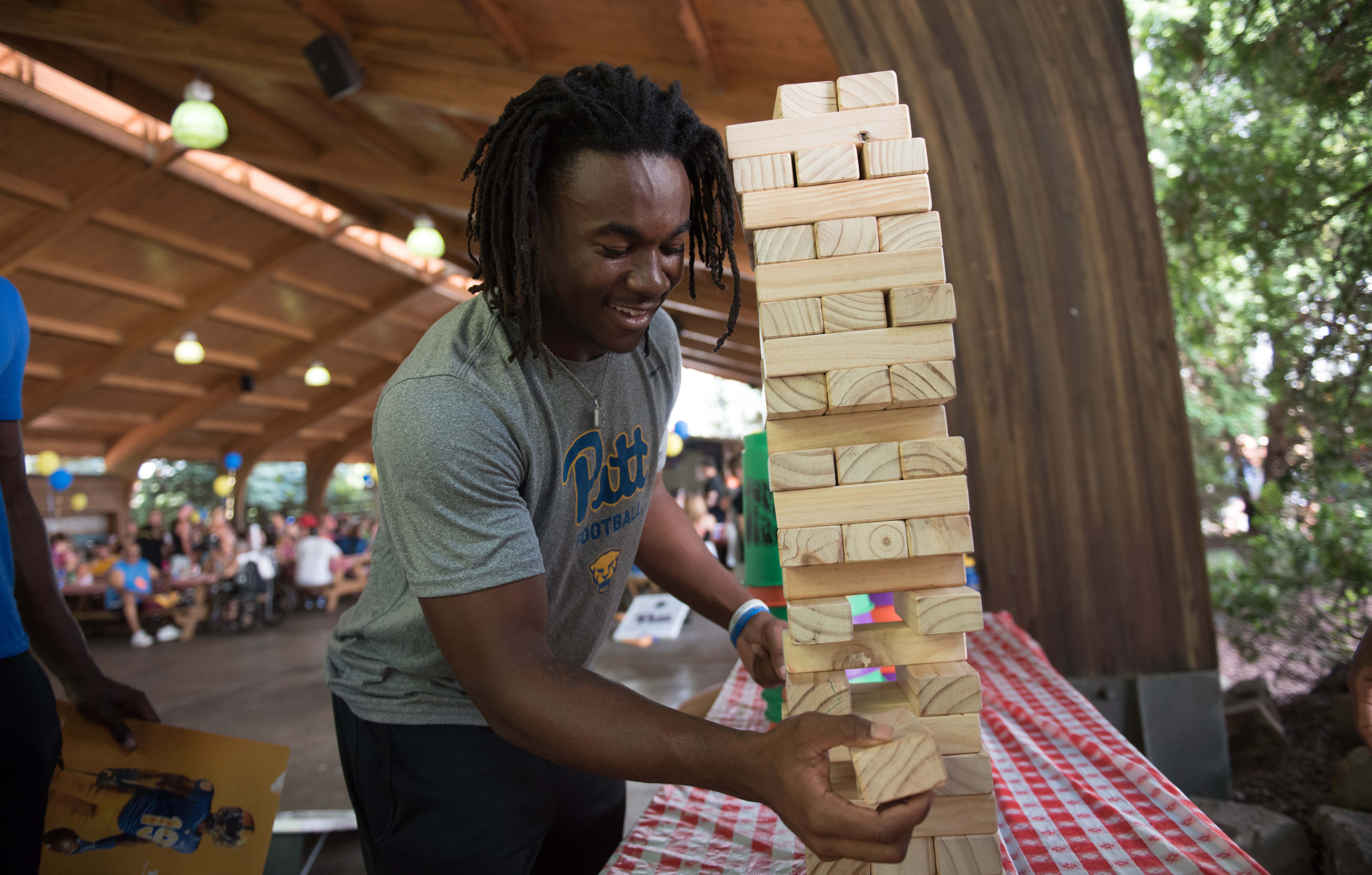 Man plays giant Jenga game