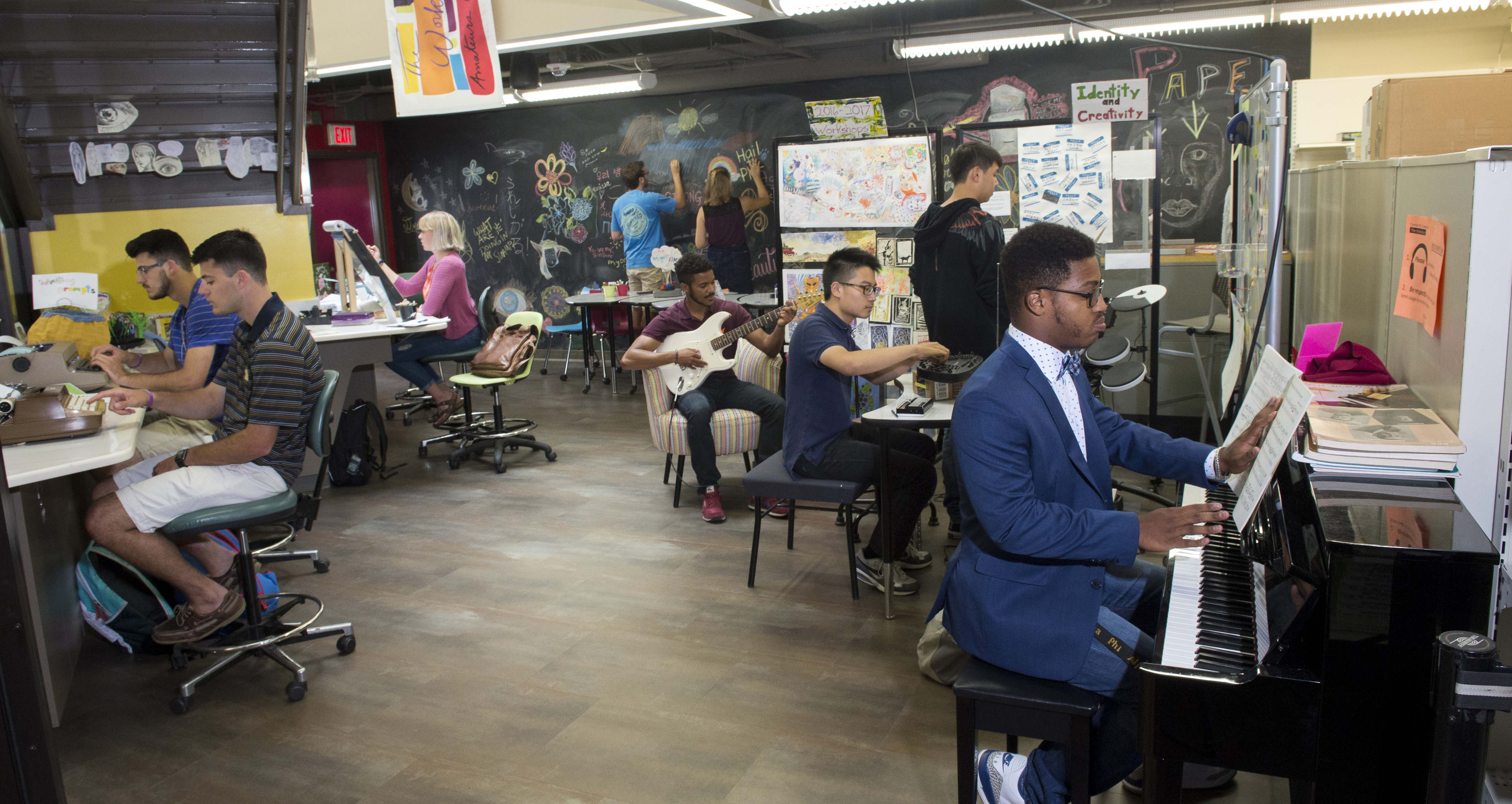 People playing instruments and making art in Center for Creativity