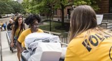 Student volunteers help people move in