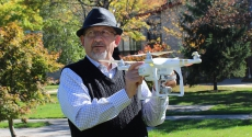 Pitt–Johnstown geography instructor Ahmad Massasati holding drone