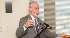 Rabbi Jeffrey Myers at podium