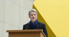 Greg Scott in front of yellow sculpture