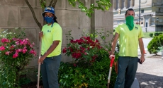 Two grounds crew workers