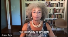 Angela Davis in front of bookcase