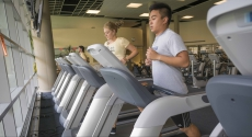 Man and woman on treadmill at Baierl fitness center