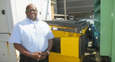 Ernest Robinson in front of yellow composter