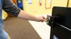 Student swipes at ID reader