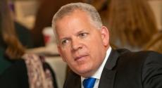 Joe McCarthy in suit and tie