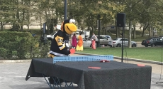 Iceburgh mascot at ping pong table