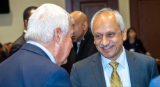 Anantha Shekhar talks to people at Board of Trustees meeting