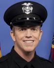 Eddie Carmack in police uniform