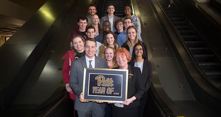 Group photo of undergraduates with Patricia E. Beeson