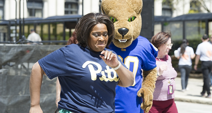 Kathy Humphrey and Roc the panther