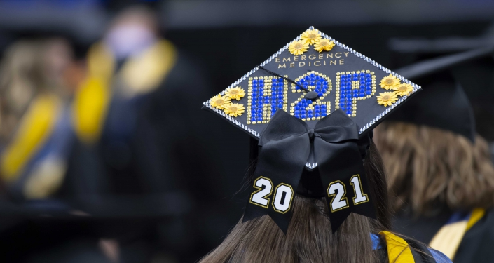 H2P hat on woman at commencement