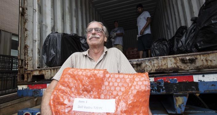Professor Steve Dytman loading up computers on truck.